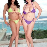 Chubby black-haired Michelle Bond and girlfriend unleash enormous all-natural fun bags from swimsuits