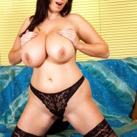 Round dark haired MILF loosing fun bags before jamming dildo into coochie in pantyhose