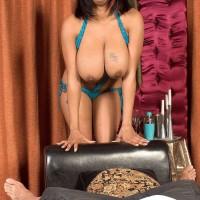 Chubby ebony dime Carmen Hayes rubbing gigantic XXX pornstar hooters and nipple licking