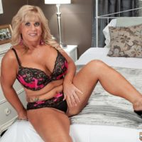 Round over fifty blond MILF Zena Rey pulling out gigantic knockers from boulder-holder while seducing stud