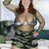 Chubby redhead MILF Virgin Brady unveiling monster-sized juggs in military fatigues