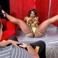 Chunky black stripper Layla Monroe demonstrating monster-sized butt in black high heels