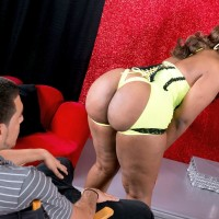 Chunky black stripper Layla Monroe demonstrating monster-sized butt in black high heels