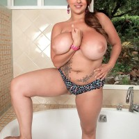 Thick MILF model Terri Jane letting huge titties fall loose from bra outdoors in high heeled shoes