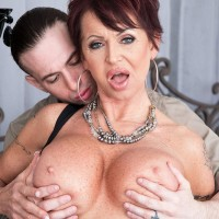 Stylish aged broad Gina Milano tempts a younger boy with her big boobies