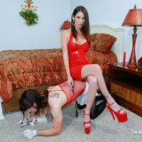 Non nude dark-haired mistress Dava Foxx training crossdressing sissy maid with cane