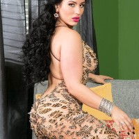 Fully-clothed Latina female Carmen De Luz twerks her immense booty while seducing a boy acquaintance