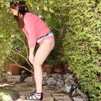 Dressed nubile Jennifer Matthews flashing upskirt panties outdoors