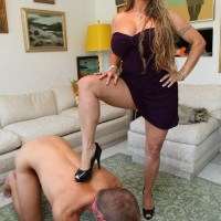 Dressed mistress Holly Halston hikes her sundress and makes her slave gobble her bum and vagina