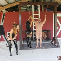 Clothed femmes Michelle and Lacy plus a gf dominate nude men outdoors