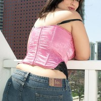Curvaceous black-haired MILF London Andrews whipping out melons for nip munching in jeans