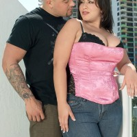 Bodacious brown-haired MILF London Andrews loosing boobies for nip tonguing in jeans