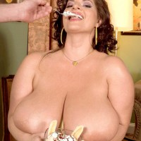 Curvaceous chick Maria Moore flashing big titties while munching food and giving BJ