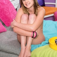 Ultra-cute teener Lizzy Bell unsheathes her puffy puny breasts as she gets naked atop her bed