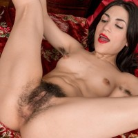 Dark-haired amateur Luna O flashes her wooly underarms and full bush at Christmas