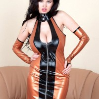 Dark haired solo girl Sha Rizel showing off no panty upskirt in latex dress and high heeled shoes