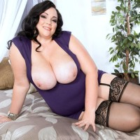 Black-haired BIG BEAUTIFUL WOMAN Charlotte Angel sets her large knockers loose of dress and melon-holder