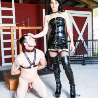 Dark-haired chick Sarah Dice dominates a masculine sub in latex outfit and long boots