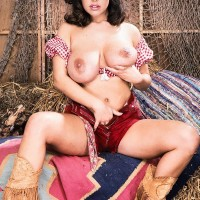 Dark-haired farm female Carrie sets her huge boobies loose in leather boots and cut-offs
