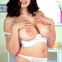 Dark-haired boob model Kerry Marie releases her immense XXX film star titties from lingerie