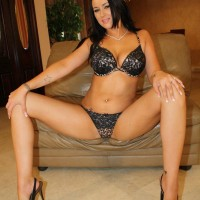Black-haired MILF Ashley showing her lovely funbags while having a cigarette