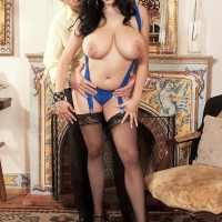 Black-haired MILF Shione Cooper vaunting massive juggs for nip sucking in tights
