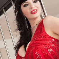 Black-haired model Joana Blessing sets her amazing tits loose of a short crimson dress in crimson heels