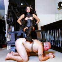 Dark-haired broad Michelle Lacy dominates her subby husband slave in hip highs