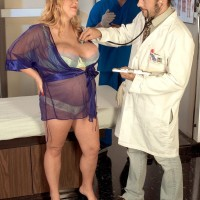 Horny ash-blonde BBW Sunshine having huge breasts caressed by medic in check-up room