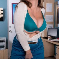 Insatiable yellow-haired MILF Janessa Loren letting melons loose from bra in home work environment