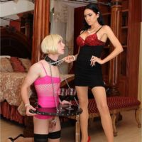 Dominant dark-haired chick Emmanuelle London abasing a crossdressing sissy maid