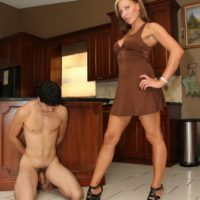 Dominant girlfriend Christine stomps her subby hubby with high-heeled shoes in the kitchen
