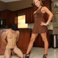 Dom gf Christine stomps her subby hubby with high heeled shoes in the kitchen