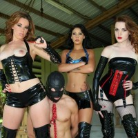 Dominatrix women Lizzie and Esmi lovemaking with Deanna to dominate a hooded masculine
