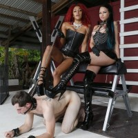 Dominatrix Daisy Ducati and her mistress dominate a masculine sub in high-heels