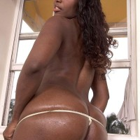 Ebony amateur Sapphira uncovering large ass from g-string panties and denim jeans