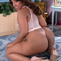 Ebony BBW Layla Monroe flaunts her large caboose in see thru sundress and thong panties