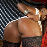 Ebony MILF Leah Ray flaunts her monster-sized butt during solo act in hosiery and high-heels