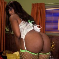 Ebony MILF Leah Summers displays her hefty ass in mesh stockings during oral sex