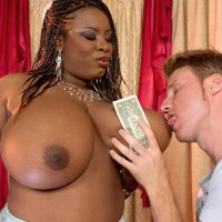Ebony stripper Mianna Thomas unsheathes her massive breasts in hose and garters