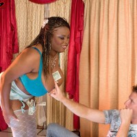 Ebony stripper Mianna Thomas exposes her huge knockers in hose and garters
