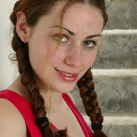 Euro amateur in braided pigtails demonstrating diminutive knockers and furry vag