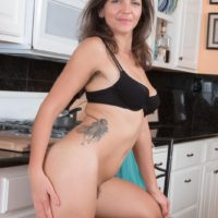 Euro first timer Katie Z vaunting furry armpits and all-natural thicket in kitchen