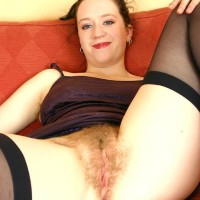 European first timer flaunting furry underarms before parting wooly vag on sofa