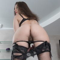 European dark haired first-timer Dea Ishtar spreading hairy cunt in hosiery and high-heels