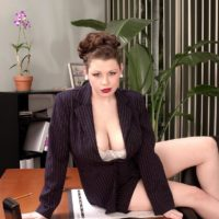 European MILF porno star Desirae flashing big upskirt butt in work place clad high-heels