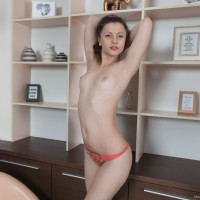 European babe Dea Ishtar baring puny fun bags and wooly snatch while stripping