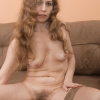 Euro solo female Elza demonstrating hairy fuckbox while rolling off tan hose