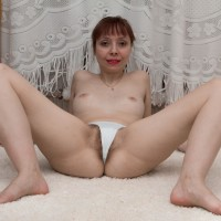 European babe with little hooters gliding panties aside to unveil fur covered honeypot