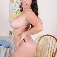 Elder dark-haired dame exposing large all-natural titties and giant ass-cheeks